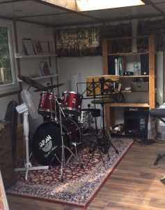 A drum kit inside a music studio