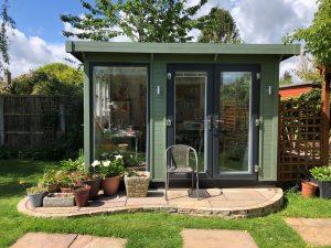 Garden studio with small patio outside.