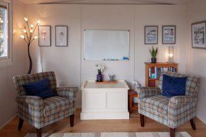 Outdoor retreat - comfy seating area inside garden office